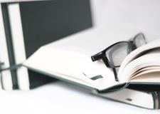 Books and glasses. Isolated pile of books and a pair of glasses Royalty Free Stock Images