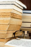 Books and Glasses. Old,gold edged  books and antique glasses  on opened book Stock Image