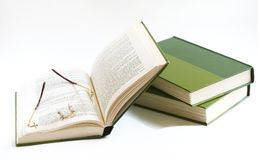 Books and glasses (back to school 2). Glasses left on open book, little rest in reeding Royalty Free Stock Images
