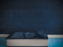 Books and glasses , Blackboard. Books and glasses , Blackboard, on the table in the classroom Royalty Free Stock Image