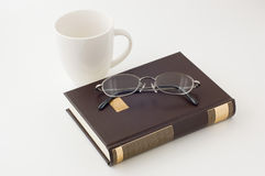 Books and Glasses and cup. Fold turn down the corner of a page, dog‐ear a book Royalty Free Stock Image