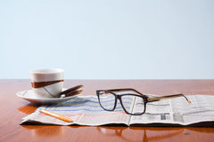 Books, glasses and cup cafe co on a wooden table Stock Photo