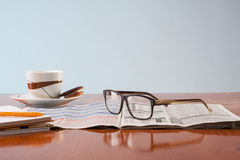Books, glasses and cup of coffee on a wooden table Royalty Free Stock Photography