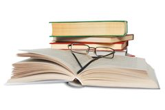 Books and glasses isolated over white. Stock Photos