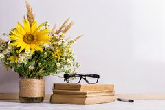 Free Books, Glasses, Markers And A Bouquet Of Flowers In A Vase On White Board Background. Concept For Teachers Day And First September Stock Photos - 155562073