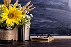 Free Books, Glasses, Markers And A Bouquet Of Flowers In A Vase On White Board Background. Concept For Teachers Day And First September Royalty Free Stock Image - 156262626