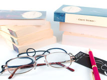 Books, glasses and pen. Books, pen and glasses royalty free stock photography