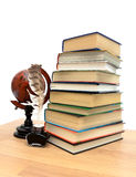 Books, globe and ink on a white background Royalty Free Stock Images