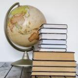 Books and globe Stock Photo