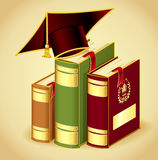Books with Graduation cap Royalty Free Stock Photography