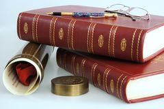 Books and graduation diploma Stock Image