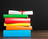 Books And Graduation Scroll Royalty Free Stock Photo