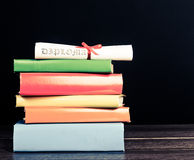 Books And Graduation Scroll Stock Photography