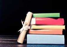 Books And Graduation Scroll Stock Photos