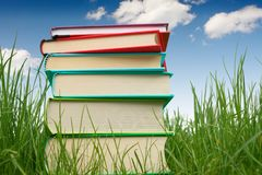 Books on the grass. Stack of books on the grass stock photography