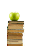 Books and green apple Stock Images