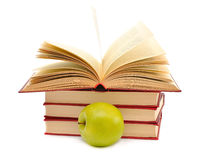 Books and green apple Royalty Free Stock Images