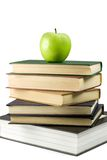 Books and green apple. Green apple on books. Isolated on white Royalty Free Stock Photo