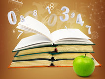 Books with green apple Royalty Free Stock Photos