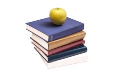 Books and green apple Stock Photos