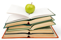Books with green apple Stock Photography