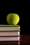 Books and green apple Royalty Free Stock Image