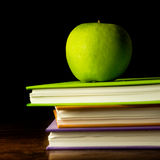Books and green apple Stock Image