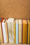 Books on grunge wooden table desk shelf in library. Back to school background with copy space for your ad text. Old Royalty Free Stock Photography