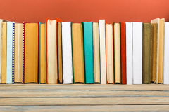 Books on grunge wooden table desk shelf in library. Back to school background with copy space for your ad text. Old Royalty Free Stock Image
