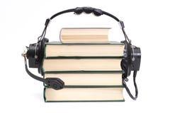 books hörlurar Arkivfoto