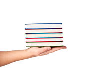 Books on hand isolated on white. Stock Images