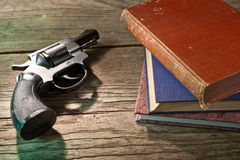 Books and handgun Stock Images