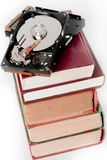 Books and hard disk. Hard disk and old books Royalty Free Stock Photography