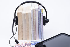 Books headphone and handheld Royalty Free Stock Image