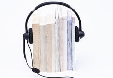 Books and headphone Stock Photos
