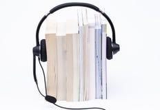 Books and headphone Stock Photos