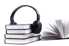 Books with headphones. Audio book concept Stock Photos