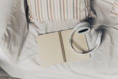 Books and headphones Stock Photo