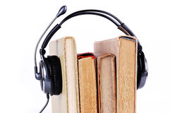 Books in headsets Royalty Free Stock Image