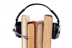 Books in headsets Stock Photography