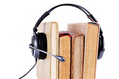 Books in headsets Royalty Free Stock Photos