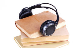 Books in headsets Royalty Free Stock Photography