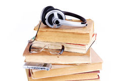Books and headsets Stock Images