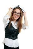 Books on her head in glasses Royalty Free Stock Images