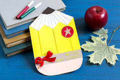 Books, homemade postcard, apple and maple leaves Stock Image