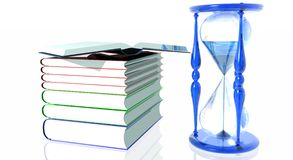 Books with Hourglass. Stack of books and blue glassy hourglass Stock Image