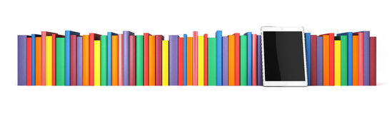 Books In A Row With The Tablet In The Foreground, Isolated On White Background Royalty Free Stock Photography