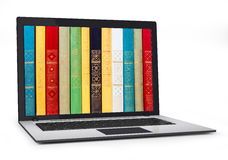 Books inside computer. Digital library - books inside computer Stock Images