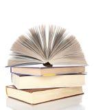 Books isolated on white background. Pile of books with one book open on white background royalty free stock photo