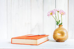 Books or journal with flowers arranged. Stock Photos